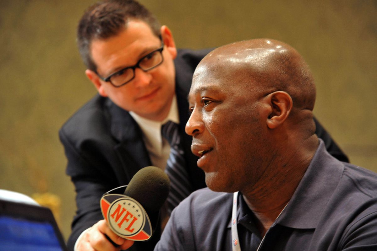 March 28,  2012; Palm Beach, FL, USA; Chicago Bears head coach Lovie Smith (right) is being interviewed by the NFL network during the NFC head coaches media breakfast at the Breakers Hotel. Mandatory Credit: Steve Mitchell-US PRESSWIRE
