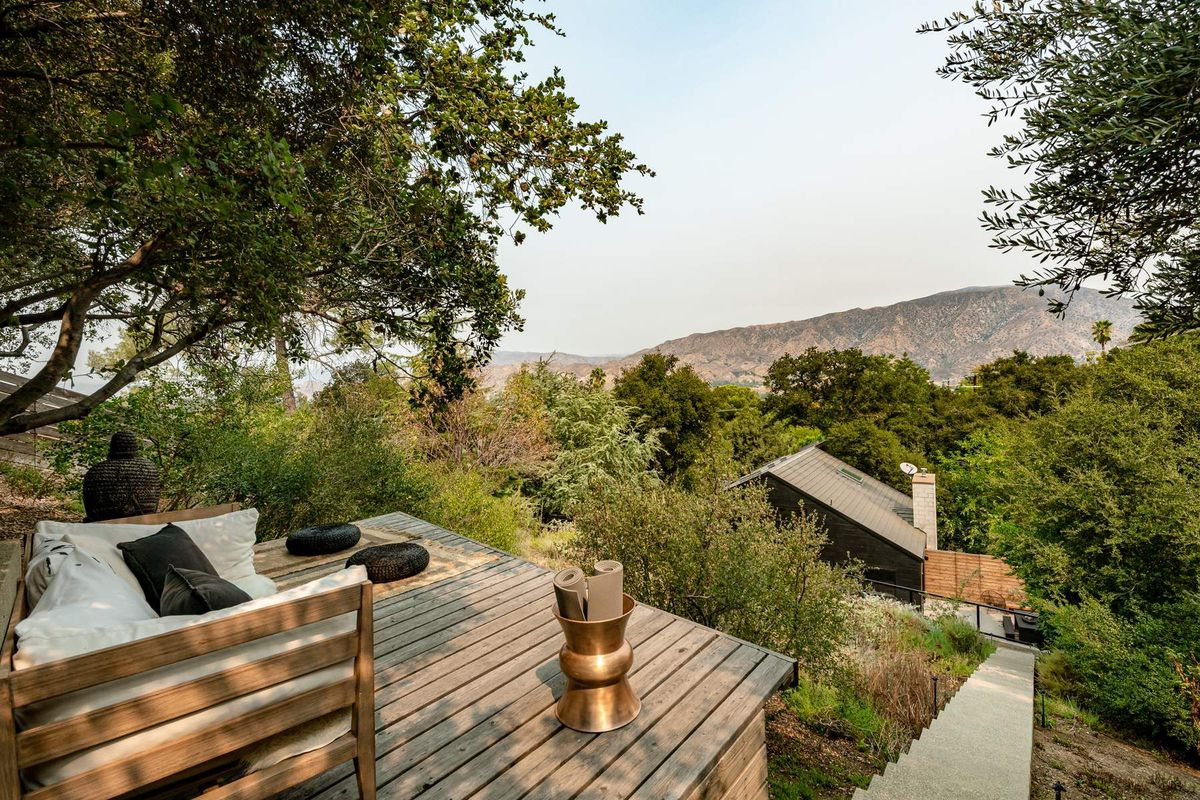 Deck with seating overlooking mountains.