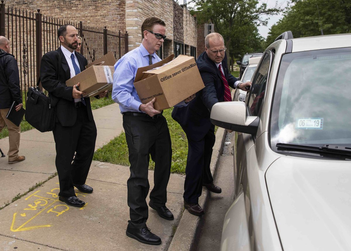 Federal agents remove boxes of material from office of Ald. Carrie Austin.