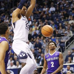 Brigham Young Cougars forward Yoeli Childs (23) prepares to dunk over the Portland Pilots in Provo on Thursday, Dec. 28, 2017.