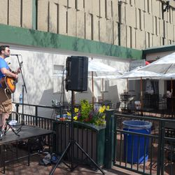 11:24 a.m. Musicians playing at the Captain Morgan Club -