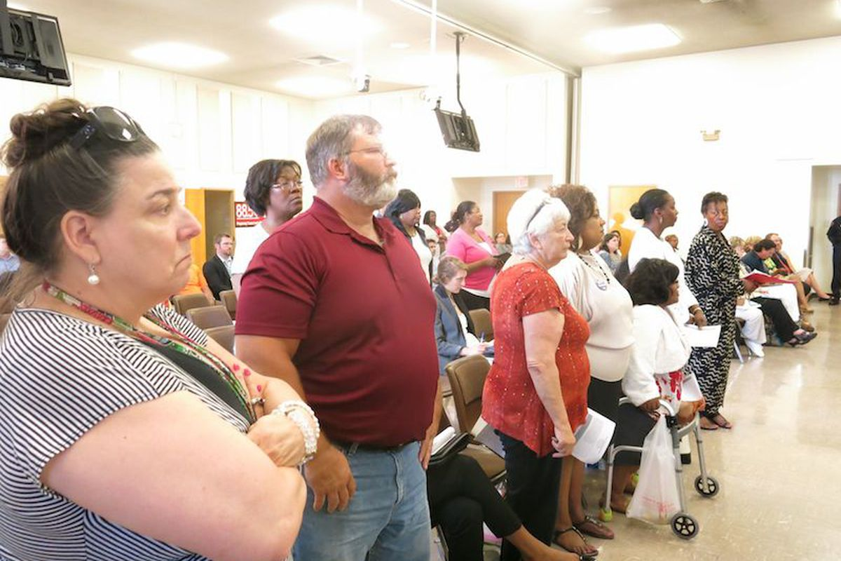 About a dozen Shelby County School teachers stood in solidarity against the district's preferred teacher hiring list and bonus pay plan.