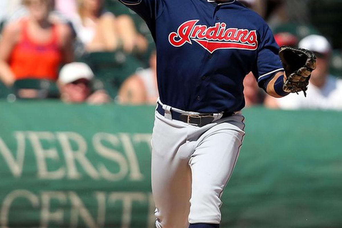 May 27, 2012; Chicago, IL, USA; Cleveland Indians first baseman Jose Lopez (4) throws to first base in the seventh inning against the Chicago White Sox at US Cellular Field. The White Sox won 12-6. Mandatory Credit: Dennis Wierzbicki-US PRESSWIRE