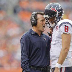 Houston Texans head coach Gary Kubiak, left, talks with quarterback Matt Schaub (8) on the sidelines during the fourth quarter of an NFL football game Sunday, Sept. 23, 2012, in Denver.