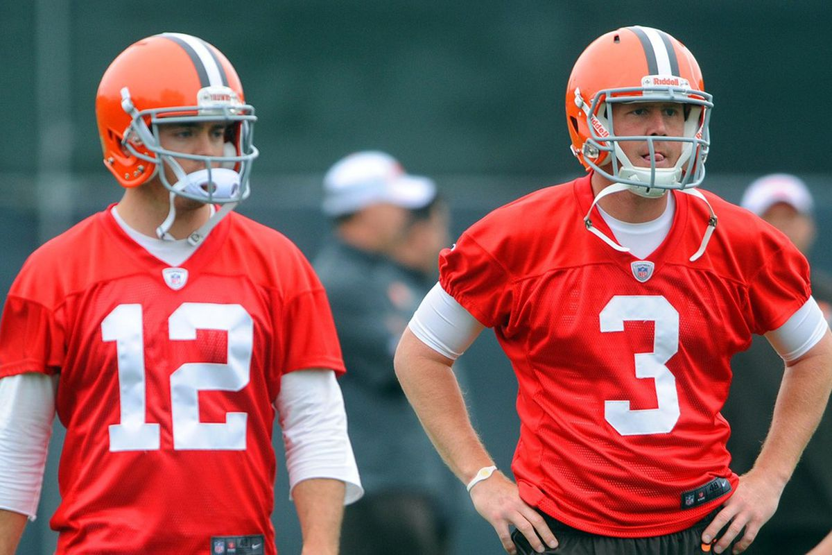 May 22, 2012; Berea, OH, USA: Cleveland Browns quarterback Colt McCoy (12) and quarterback Brandon Weeden (3) during organized team activities at the Cleveland Browns training facility.  Mandatory Credit: Eric P. Mull-USPRESSWIRE