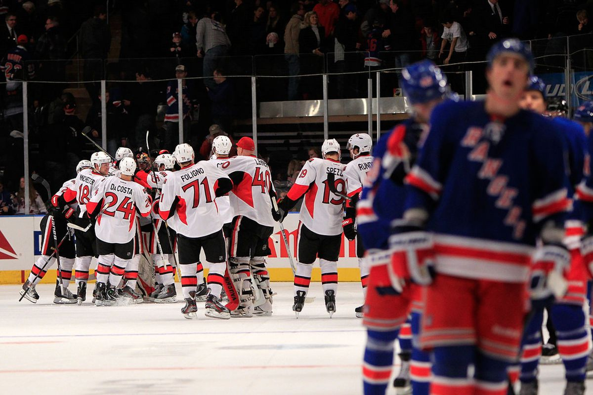 Milan Michalek (9) of the Ottawa Senators is congratulated by his teammates on his game winning goal against the New York Rangers at Madison Square Garden on October 29, 2011 in New York City.  (Photo by Chris Trotman/Getty Images)