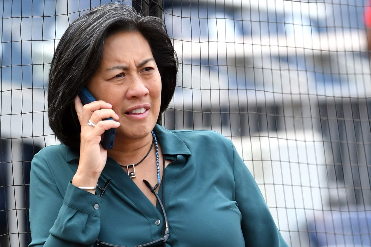 General manager Kim Ng of the Miami Marlins on the phone during batting practice of a baseball game against the Washington Nationals at National Park