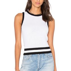 This preppy tennis sweater has an unexpected back cut-out for a little edge. Pair it with a skirt or jeans in summer, or wear it as a layering piece with a dress or collared shirt in colder months.