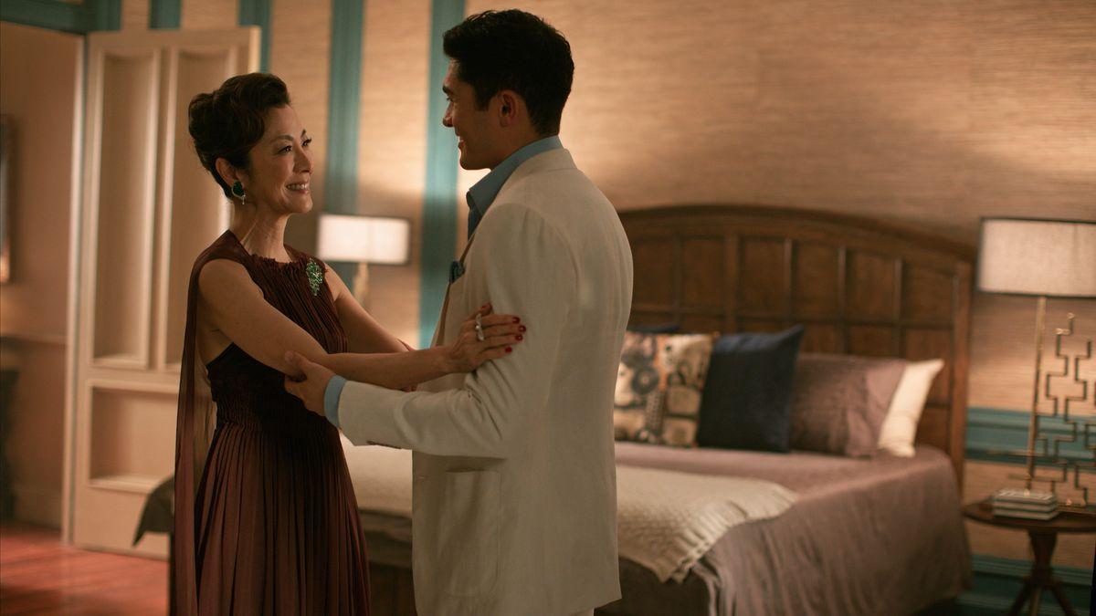 Michelle Yeoh as Eleanor Young and Henry Golding as Nick Young in Crazy Rich Asians