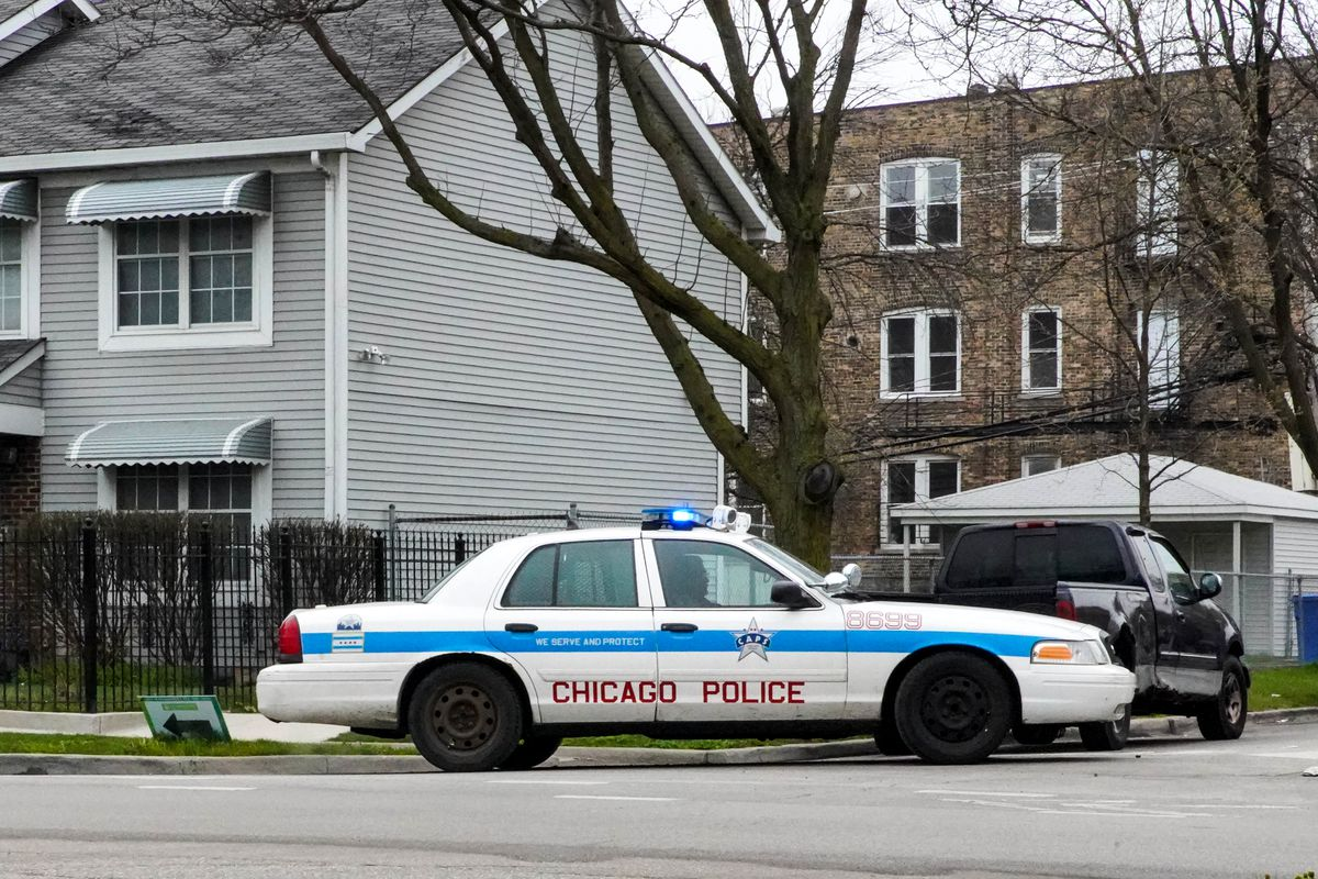 A Chicago police squad car sits at Monroe and Hamlin in the Harrison District Friday, April 24, 2020.