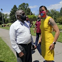 The Rev. France Davis, pastor emeritus of Calvary Baptist Church, left, and Salt Lake City Mayor Erin Mendenhall talk after a press conference to announce the Salt Lake City Commission on Racial Equity in Policing at the International Peace Gardens in Salt Lake City on Thursday, June 25, 2020.