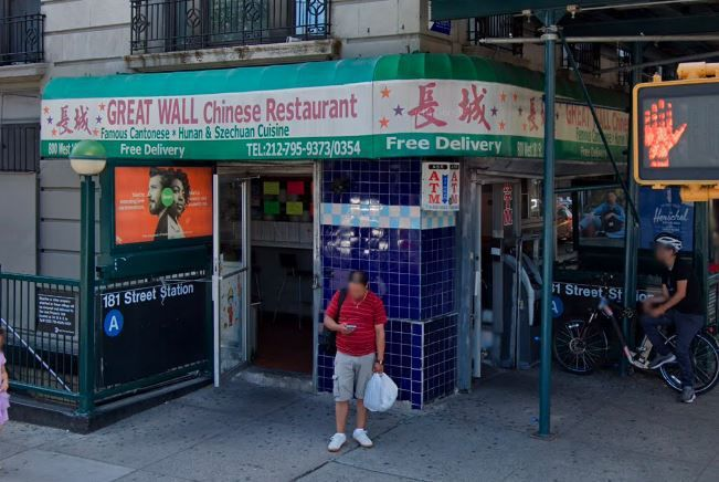 A corner Chinese restaurant over a subway stop.