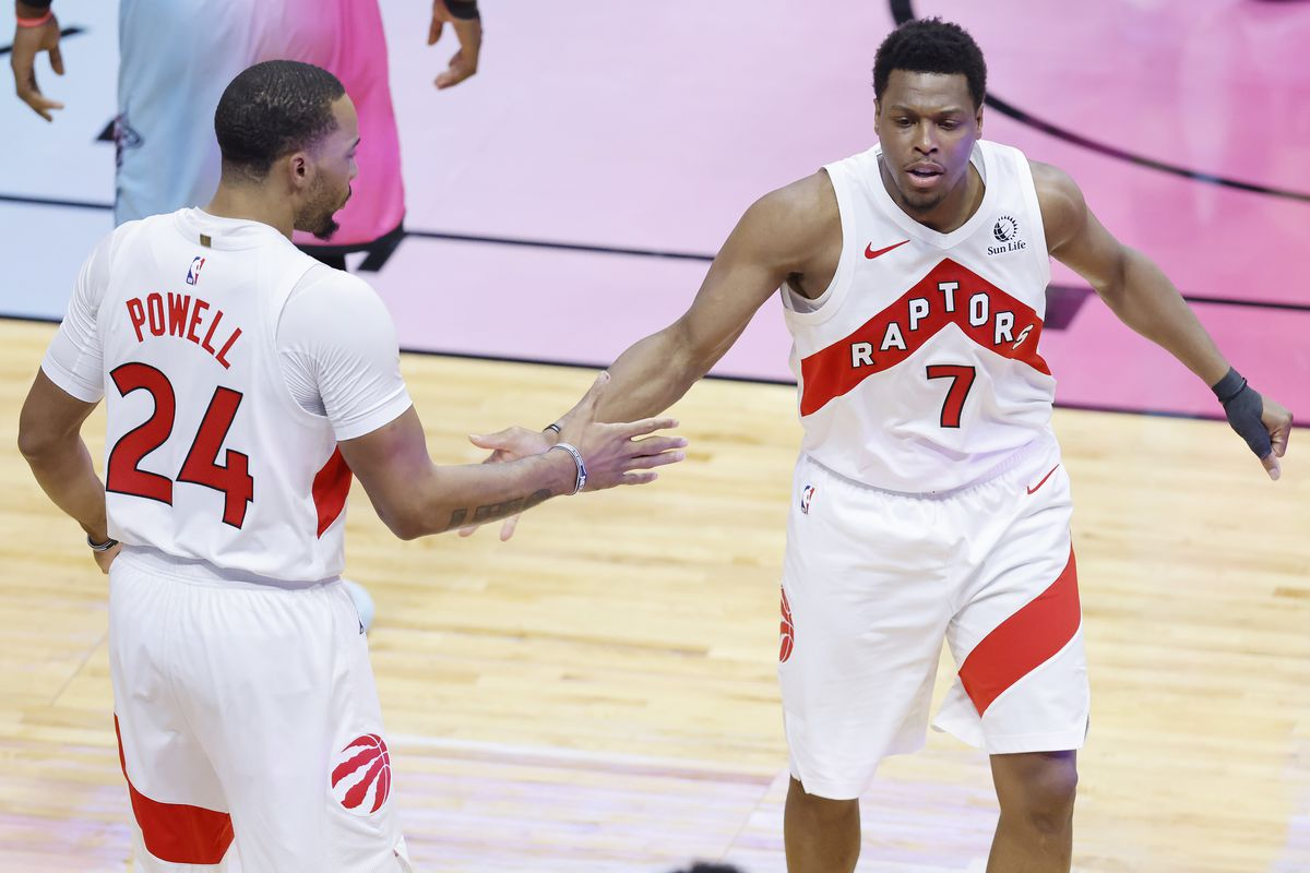 Kyle Lowry of the Toronto Raptors celebrates with Norman Powell against the Miami Heat during the second quarter at American Airlines Arena on February 24, 2021 in Miami, Florida.