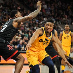 Utah Jazz guard Donovan Mitchell (45) dribbles around Houston Rockets forward Tarik Black (28) as the Utah Jazz host the Houston Rockets at Vivint Smart Home Arena in Salt Lake City on Thursday, Dec. 7, 2017.
