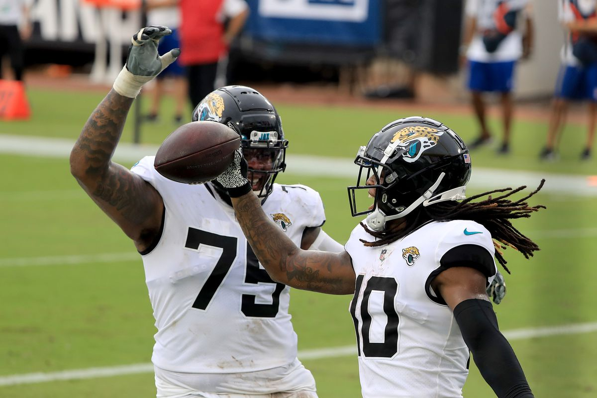Laviska Shenault Jr. of the Jacksonville Jaguars celebrates a touch down with Jawaan Taylor during the game against the Indianapolis Colts at TIAA Bank Field on September 13, 2020 in Jacksonville, Florida.