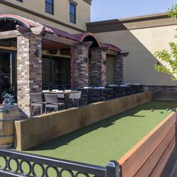 The bocce ball court and patio