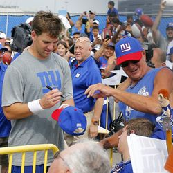 Eli Manning signs autographs. [Jim O'Connor-USA TODAY Sports]