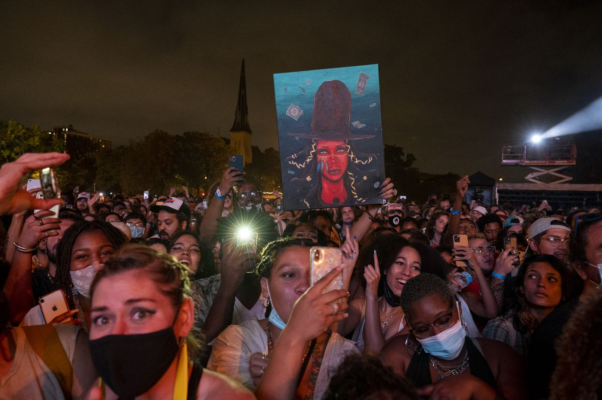 A fan holds up a painting of Erykah Badu during the singer's set at Pitchfork music festival at Union Park on Sunday, Sept. 12, 2021.