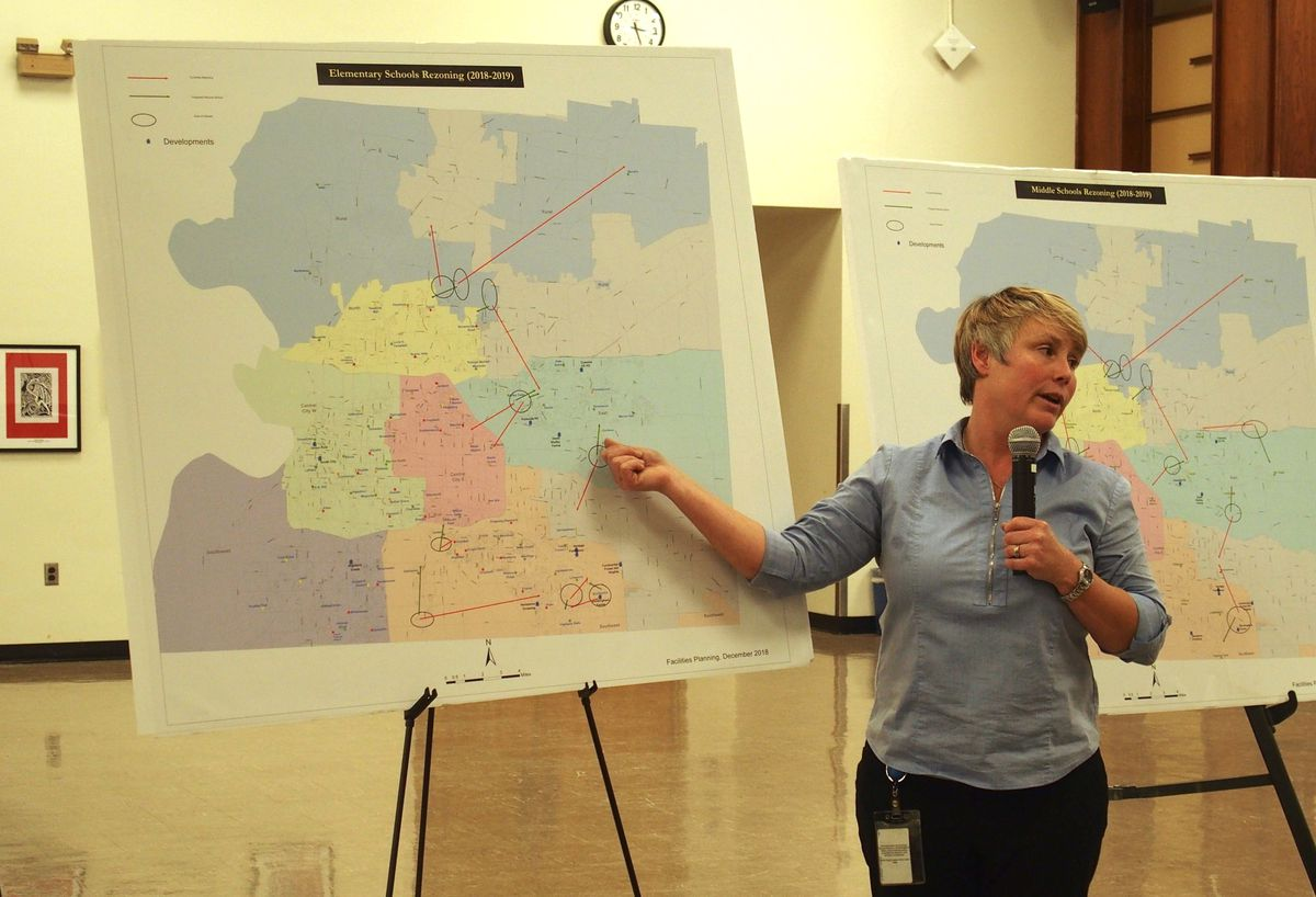 Michelle Stuart, the district's manager of facility planning and property management, presents a the rezoning plan in December.