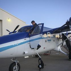Lt. j.g. J.C. Clark, copilot, does his preflight checks on the Twin Otter DHC-6 before taking off from the Salt Lake City International Airport in Salt Lake City on Sunday, Feb. 12, 2017. The National Oceanic and Atmospheric Administration (NOAA) has been flying over Salt Lake, Cache and Utah valleys to survey chemical conditions responsible for the formation of particulate pollution, known as PM2.5.