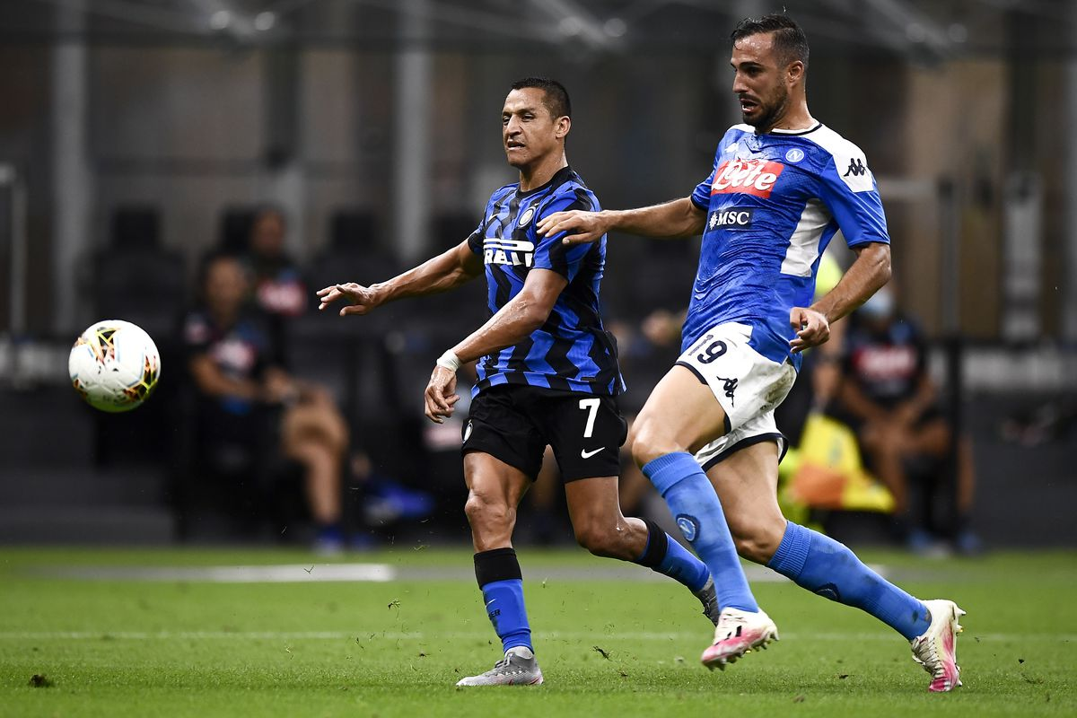 Alexis Sanchez (L) of FC Internazionale is challenged by...