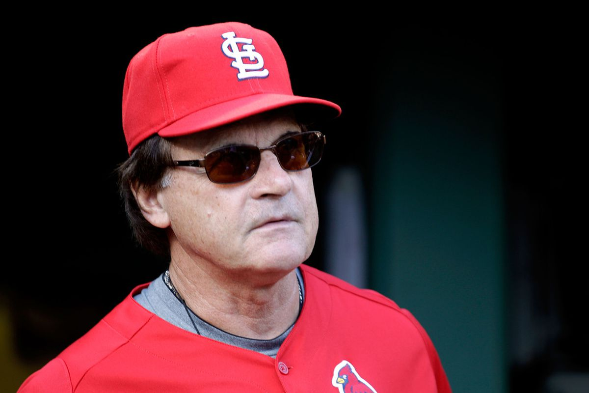 Manager Tony La Russa stands in the dugout prior to Game Four of the MLB World Series against the Texas Rangers at Rangers Ballpark in Arlington, Texas.  (Photo by Rob Carr/Getty Images)