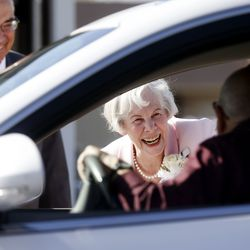 Enoch and Ann Bell are greeted by well-wishers who drove by after their wedding ceremony in Kaysville on Friday, April 24, 2020.