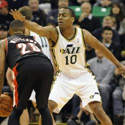 Utah Jazz point guard Alec Burks (10) has his hand in the face of Portland Trail Blazers point guard Mo Williams (25) in the second half of a game at the Energy Solutions Arena on Wednesday, October 16, 2013.