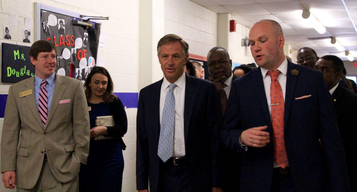 Halsam (middle) walks alongside state Sen. Brian Kelsey and Aspire Coleman Principal Owen Ricciardi.