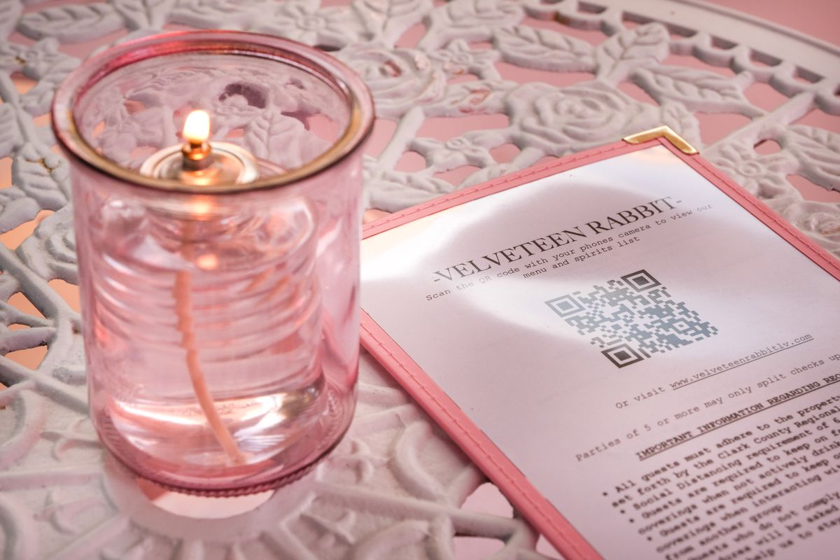 A menu and a candle on a table