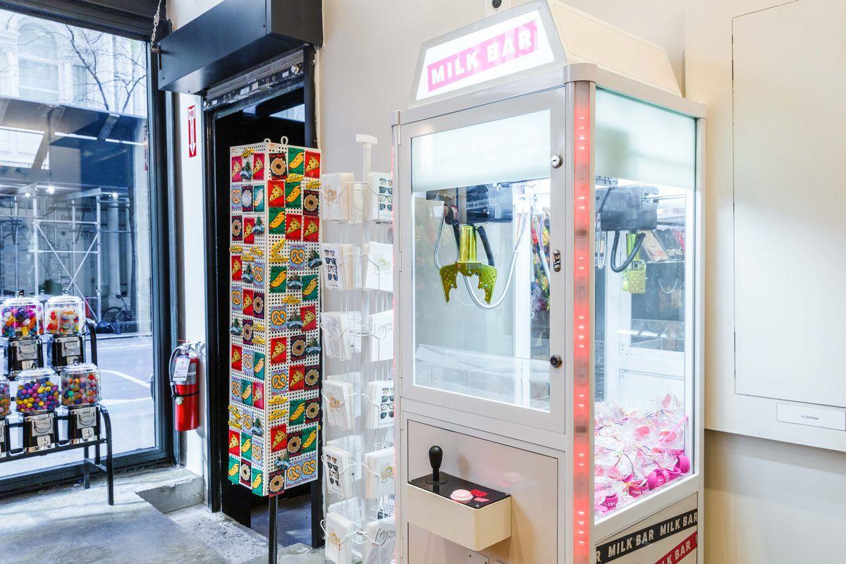 An arcade-style claw machine labelled Milk Bar