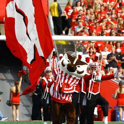 Bucky Badger leads the team on to the field