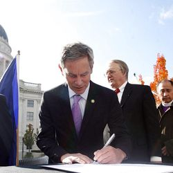 Salt Lake Mayor Ralph Becker signs a document known as the Utah Compact during a press conference where community leaders gathered in support of immigration reform at the State Capitol in Salt Lake City Thursday, Novmeber 11, 2010.
