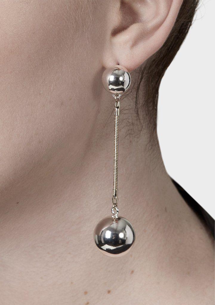 pendulum earrings on model