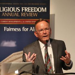"""Utah State Senate Majority Leader J.Stuart Adams, R-Layton, speaks during a session on """"Working with State and Local Governments on Religious Freedom Issues"""" during the BYU law school conference on religious freedom, """"Fairness For All,"""" July 6, 2015, in Provo."""