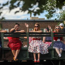 Members of the Battlin' Betties, a pin-up group, smile and wave during the Grand Parade in Provo on Monday, July 5, 2021.