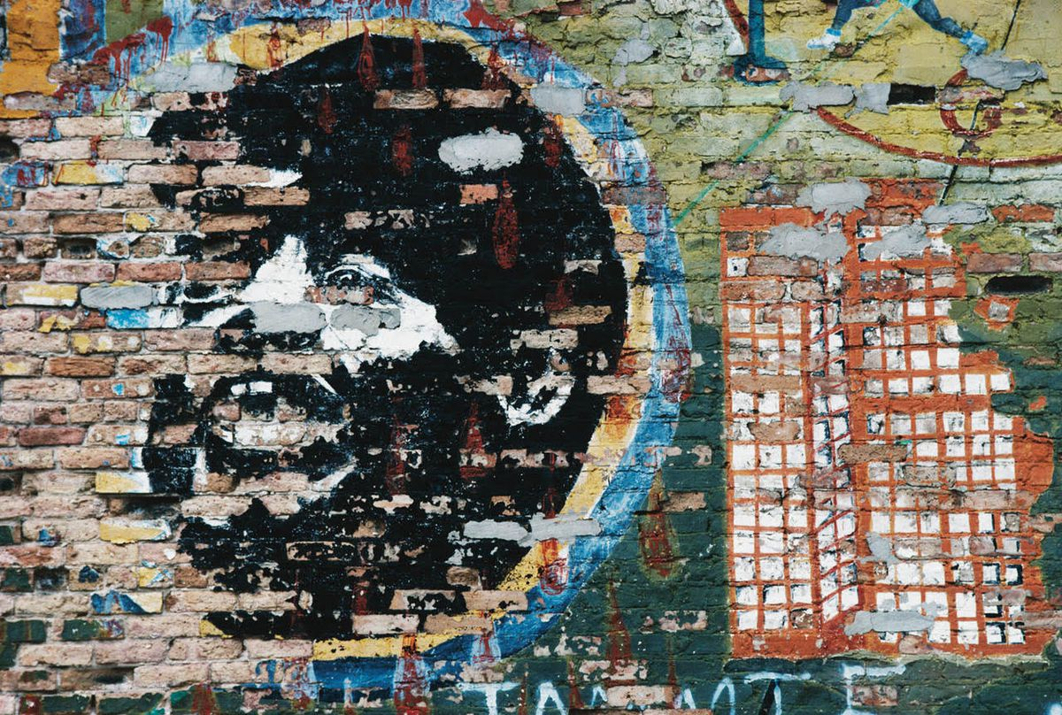 A now-gone mural of Fred Hampton Sr. at Madison Street and Hoyne Avenue.