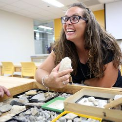 Carli Johnson looks at fossils during the grand opening of the new Tracy Hall Science Center at Weber State University in Ogden on Wednesday, Aug. 24, 2016.