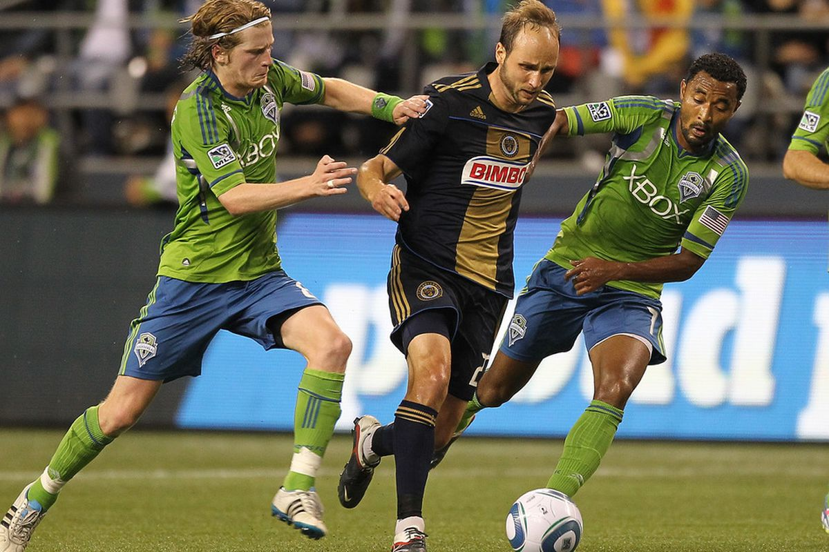 SEATTLE - OCTOBER 08:  Justin Mapp #22 (C) of the Philadelphia Union battles Erik Friberg #8 (L) and James Riley #7 of the Seattle Sounders FC at CenturyLink Field on October 8, 2011 in Seattle, Washington. (Photo by Otto Greule Jr/Getty Images)