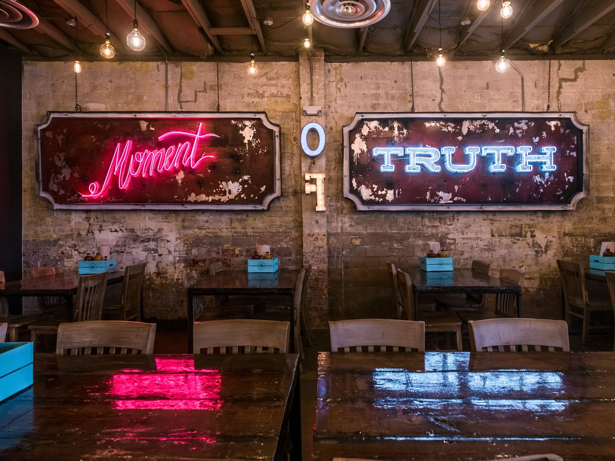 """""""Moment of Truth"""" neon sign at Truth BBQ"""