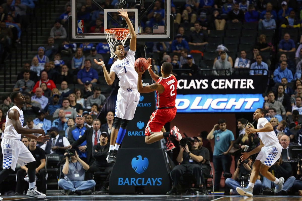 Ohio State's Marc Loving skying into the lane for a layup against Kentucky