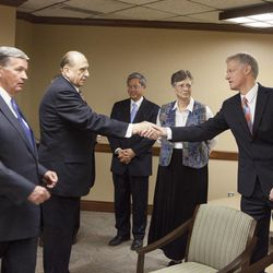 LDS Church President Thomas S. Monson shakes hands with then-BYU vice president Kevin Worthen on Sept. 15, 2009. President Cecil Samuelson, far left, was greeting President Monson with some of the other members of BYU's President's Council, then-vice president Gerrit Gong, center rear, and vice president Sandra Rogers.