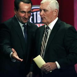 Basketball Hall of Fame inductee and coach Robert Hurley Sr., right, is escorted by coach Mike Krzyzewski during enshrinement ceremonies in Springfield, Mass., Friday.