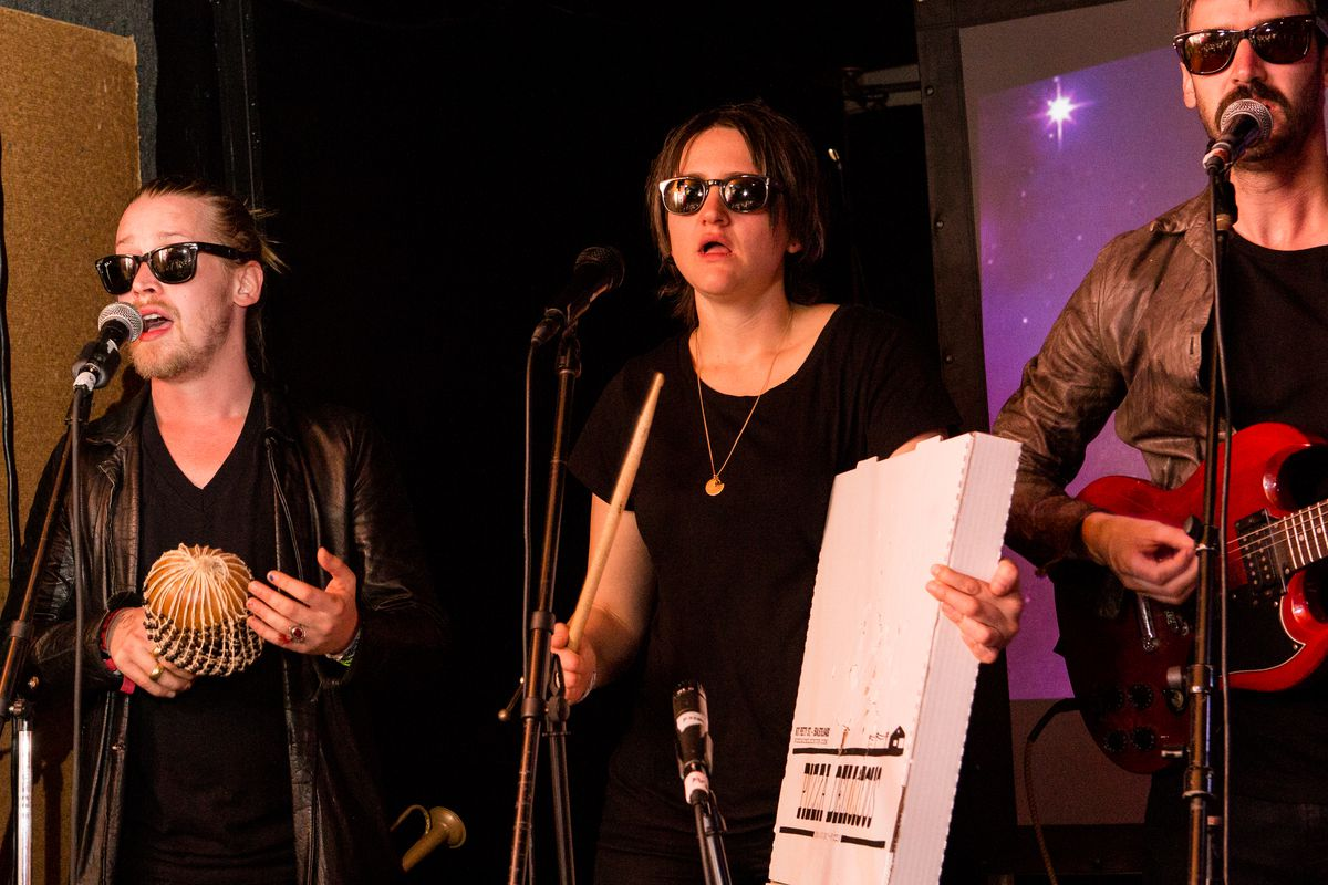 (L-R) Macaulay Culkin, Deenah Vollmer and Matt Colbourn of Pizza Underground perform onstage at The Hi Ho Lounge on March 17, 2014 in New Orleans, Louisiana.
