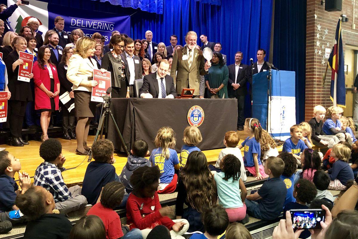 Dozens of Stedman Elementary kindergarteners look on as Gov. Polis signs the full-day kindergarten bill into law.