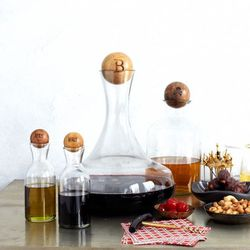 """<b>West Elm</b> Bottles with Wood Stoppers, <a href=""""http://www.westelm.com/products/glass-bottles-with-wood-stoppers-c434/?pkey=e%7Cdecanter%7C2%7Cbest%7C0%7C1%7C24%7C%7C1&cm_src=PRODUCTSEARCH