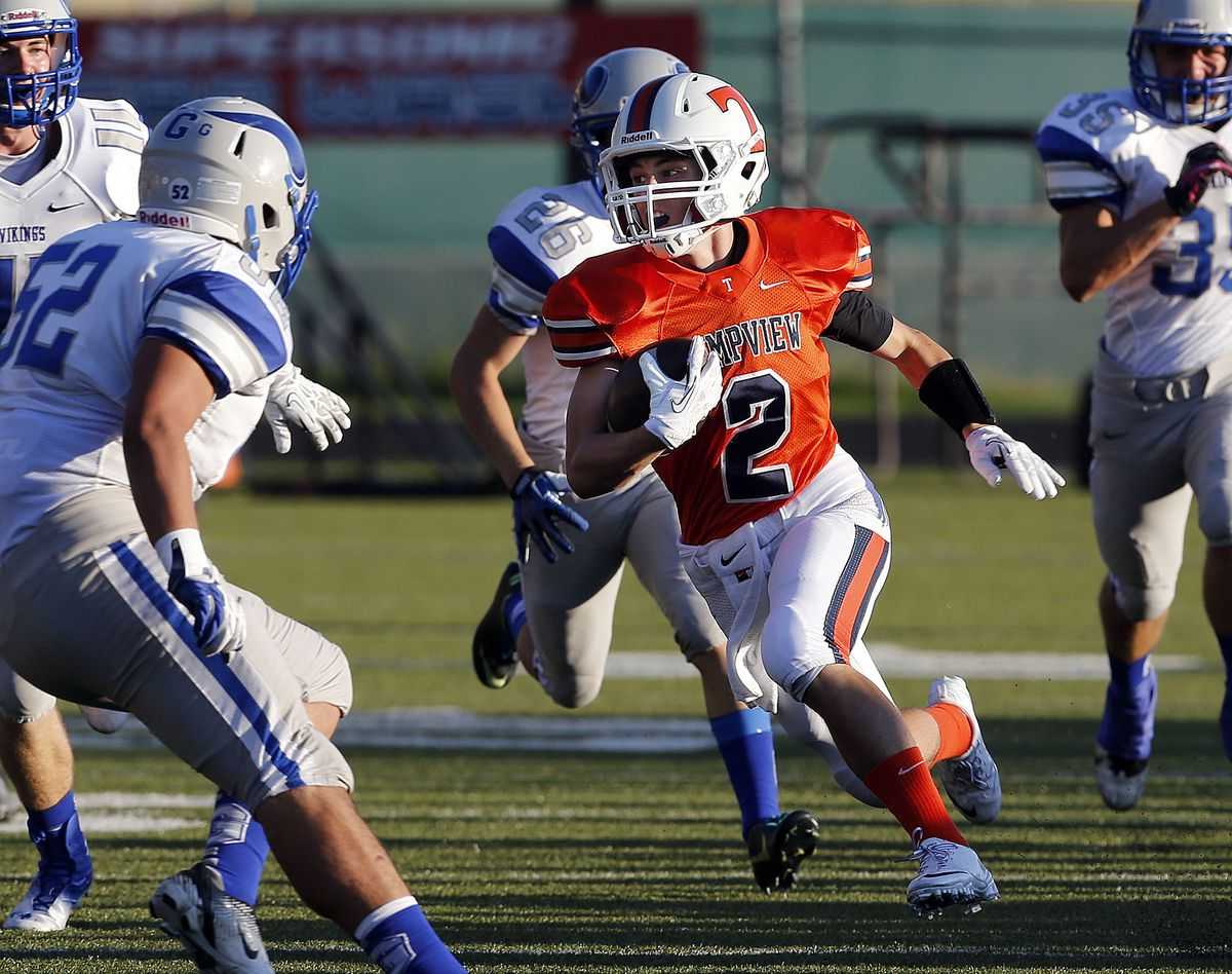 Britain Covey of Timpview runs the opening kickoff back for a touchdown against Pleasant Grove in high school football played in Provo, Friday, Aug. 30, 2013.