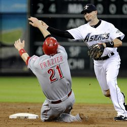 Cincinnati Reds' Todd Frazier (21) puts his hands up as he slides into second and Houston Astros' Tyler Greene throws to first to complete the double play on Reds' Scott Rolen in the second inning of a baseball game Friday, Aug. 31, 2012, in Houston.