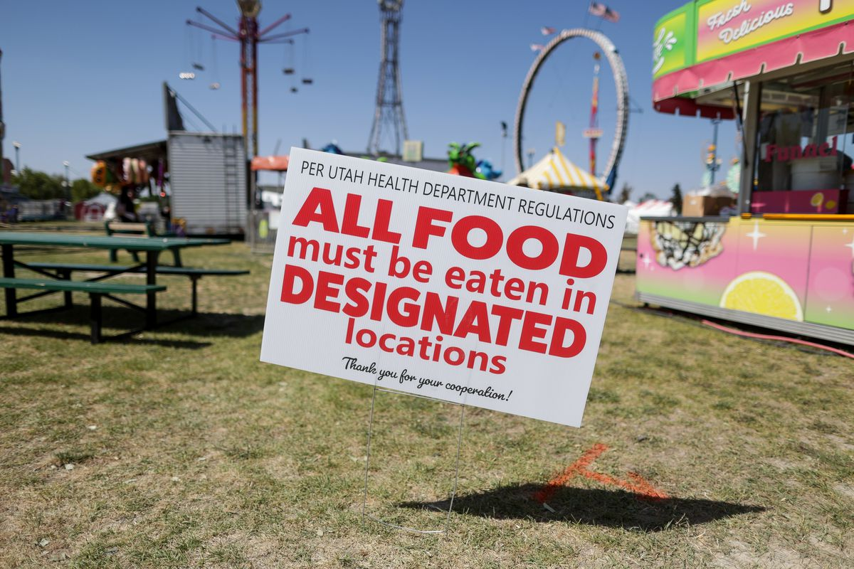 A sign indicates that people must eat only in designated areas, part of the Utah State Fair's COVID-19 precautions, at the fairpark in Salt Lake City on Friday, Sept. 11, 2020.