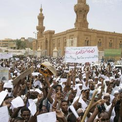 Sudanese protesters chant slogans in Khartoum, Sudan, Friday, Sept. 14, 2012, as part of widespread anger across the Muslim world about a film ridiculing Islam's Prophet Muhammad. Germany's Foreign Minister says the country's embassy in the Sudanese capital of Khartoum has been stormed by protesters and set partially on fire. Minister Guido Westerwelle told reporters that the demonstrators are apparently protesting against an anti-Islam film produced in the United States that denigrates the Prophet Muhammad.